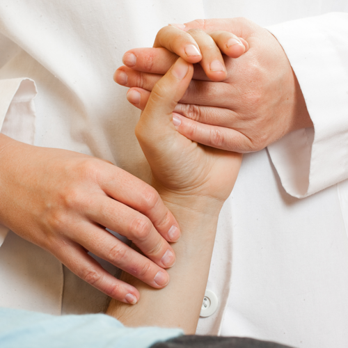 A doctor using acupressure to treat a patient.